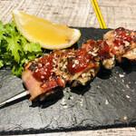 春吉三丁目鉄板バルTABELI - 牡蠣とベーコンの鉄串焼き