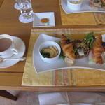 14784057 - サンドイッチとカフェオレ。(左上のお菓子はビールのおつまみです。)