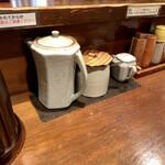 147972894 - 卓上調味料(塩だれ、辛子高菜、お酢)