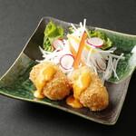 北海道料理ユック - 蟹みその入った紙クリームコロッケ。