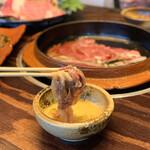 148393195 - 鹿児島黒牛の特選ロースプルコギはすき焼きのように溶き卵に絡めて