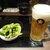 もつ鍋田しゅう - 料理写真:突き出しの枝豆とビール(中)