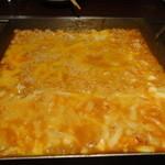 てこ舞 - シメの雑炊!チーズは半分かけました