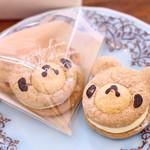 シュマン - カスタードクリ―ムをふわふわココア生地でサンドした、くまんちゃんの顔形ブッセ!!(1個¥180)