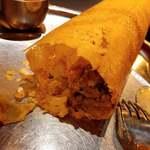 ヴェジハーブサーガ - グリーンピースや青バナナの スパイス炒めが入ったドーサだよ
