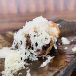 クロモリ - ⑤ 仙台牛スネ肉+新玉葱+プチヴェールの春巻、ゴルゴンゾーラ掛け