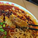 紅虎餃子房 - はみだしパイグータンタン麺