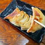 くろちゃん - 料理写真:当店自慢のくろちゃん餃子