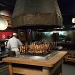 150581757 - 内観 囲炉裏で焼かれる魚