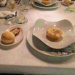 シェ・ブラウゼ - 料理写真:帆立のグラタンです。グレープフルーツを器にしてるところがおもしろい。ベシャメルソースとグレープフルーツの果肉の取合わせが意外にもうまい