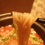 15134803 - マライ・ラーメン;麺を持ち上げて