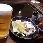 15530047 - 生ビールはサッポロ!イカゲソ鉄板焼き 390円は定番で、ビールのつまみに最適!