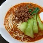 156847244 - 担々麺のアップ 赤味噌の風味が心地良い肉味噌と                       苦味がいい感じの青梗菜が載ってた