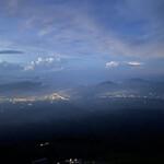 157389517 - 富士吉田市内の夜景です。奥の積乱雲から雷が発生するのが見れました。まさに神の視点です!