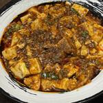 天鴻餃子房 - 麻婆豆腐はみためよりあっさりしています 辛味も控えめで軽い酸味がクセになる