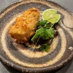 U.KAI - 北海道厚岸湾仙鳳趾の牡蠣のフリット 刻んだピータンと甜麺醤