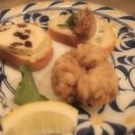 山猫バル - タパス三種(お好み)。 カキの燻製~、タチのフリット、レーズンバターといちじく…