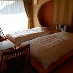 夢紡ぎの宿 月の渚 - 光がまぶしいベッドルーム