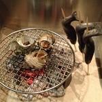 16294394 - サザエのいしる(魚醤)焼き&イワナの串焼き