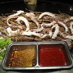 ロック ストック 西中洲店 - ナッチ(手長ダコの刺身)。活造りではなく湯引きしてあります。