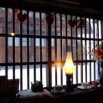 16650787 - 吹雪く雪景色が見える店内からの情景