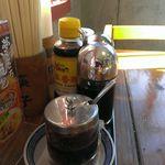 16775709 - 卓上の調味料達、自家製ラー油と中国の酢がポイント高し!