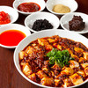 DRAGON酒家 - 料理写真:数々のスパイスが融合し、四川花山椒の香りが溢れる「龍式麻婆豆腐」