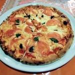 16947854 - 薪窯焼マルゲリータ 1300円トマトもうまく水分が飛んでいます。