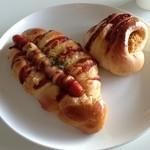 モンタボー - 料理写真:牛肉コロッケパンと ピリ辛ソーセージパン? だったかな? うろ覚え(^_^