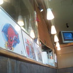 シーフードダイニング 魚座亭 - 店内にはさかなクンのイラスト