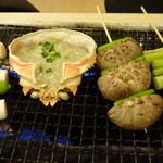 磯丸水産 - ねぎ・しし唐、蟹味噌甲羅焼、しいたけ・しし唐、アスパラ