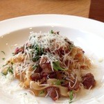 オステリア - 鴨のトマト煮込みソース。リコッタチーズは、あとのせ。