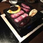 17970376 - アツアツの熔岩プレートで、お肉、野菜、魚貝類などを焼きます