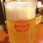 みやら - 今日の晩飯は沖縄料理屋さん。まずはオリオンビールで乾杯。