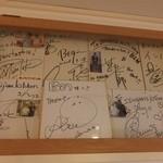18464249 - 芸能人のサインが飾ってありました。