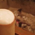 18598713 - 生ビールは竹製ジョッキに注がれる