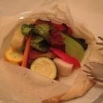 18610205 - ★7季節野菜と穴子の紙包み焼き、燻製風味 トングがかわいい♡