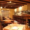 トラットリアイルポンテ - 内観写真:イタリアの田舎風なこだわった店内