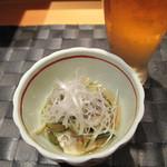 Yamachou - お通し。鯛の皮の湯引きの和え物。