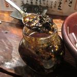 18875895 - もつ煮に付いてくる黒ラー油