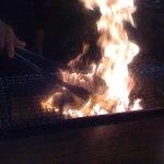 1896848 - 地鶏のもも焼きを焼いているところです。