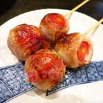 ゴールデンもつ - ミニトマト豚肉巻き(2本)250円