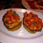 19076110 - フルーツトマトのブルスケッタ。トマトの甘みとコクがタダモノではない。