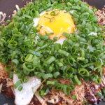 おこのみかふぇMoCo - お好み焼きの人気メニューのスタミナ玉です。豚、すじコン、キムチ、卵入りです。