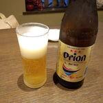 黄金の角煮と奄美焼酎90種 奄んちゅ - オリオン瓶ビール