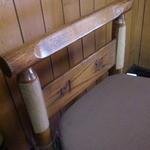 19627624 - 椅子には店名が彫られている