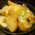 鶴橋風月 - 豚肉とじゃがいものとろとろ焼き