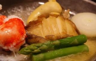 蟹工船 - たらば蟹と活鮑のステーキ