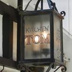 TOM -