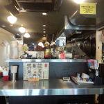 20324132 - 店内 カウンター席の奥は結構広めのテーブル席